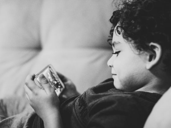 kid watching video on the phone